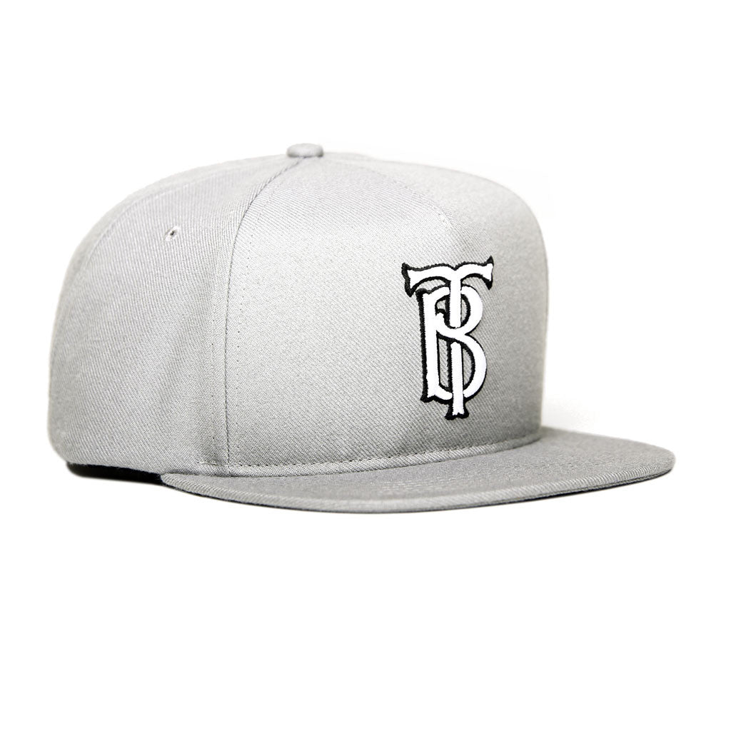 Tilted Brim Interlock Snapback Hat