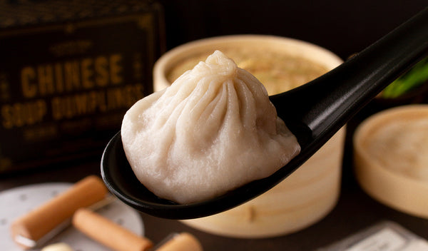 Cooked chinese soup dumpling in spoon