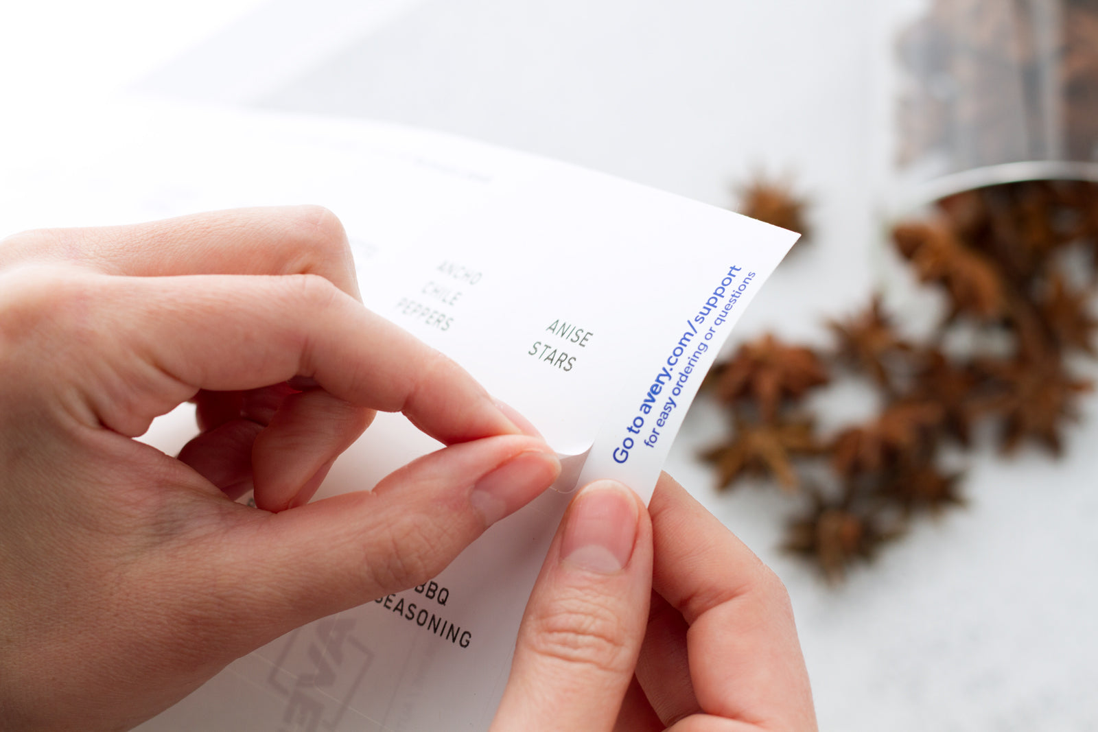 Peeling off spice jar labels from printed sheet