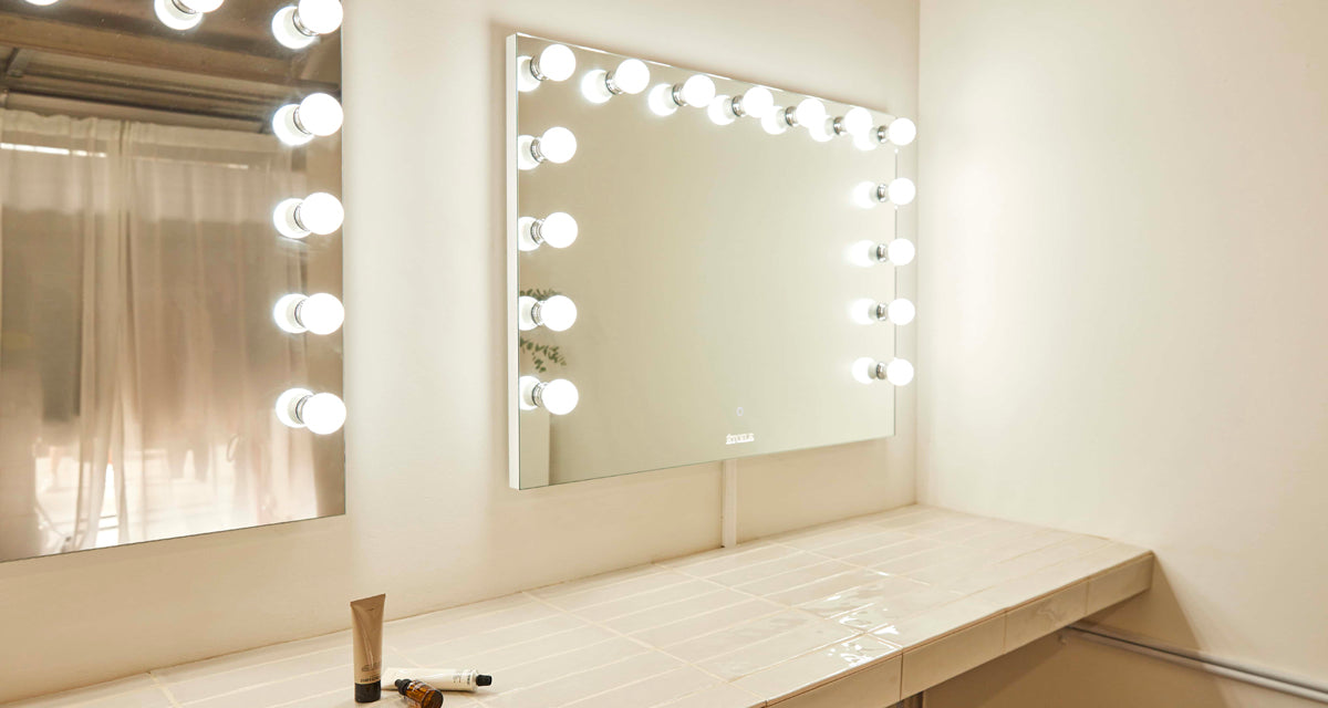 mounting a makeup vanity mirror on the wall