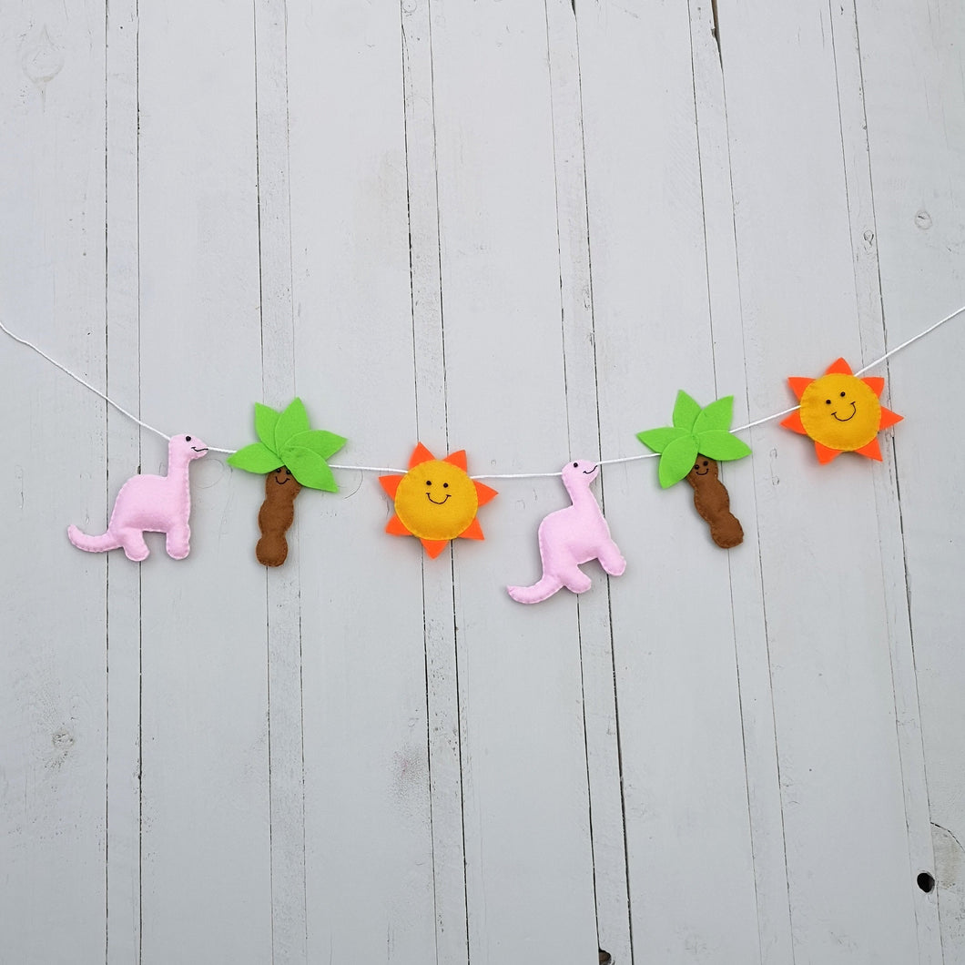 Happy dinosaur nursery banner with assortment of colours