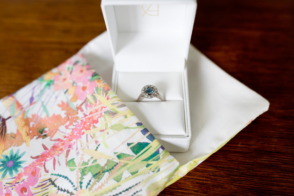 Sapphire and diamond halo ring in box
