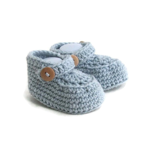 knitted baby loafers with double button strap handmade in blue merino wool by Warm and Woolly