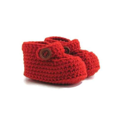 knitted baby loafers with double button strap handmade in burnt orange merino wool by Warm and Woolly
