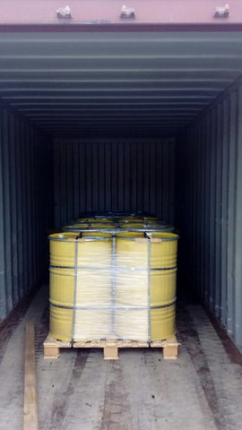 3. Honey purchased in 300kg drums, being loaded here into a 20ft shipping container