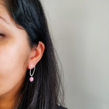 indian woman wearing pink earrings