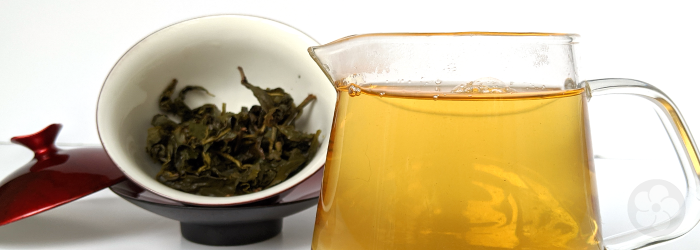 large pitcher of tea, filled with several infusions from a single serving of leaves in a small gaiwan