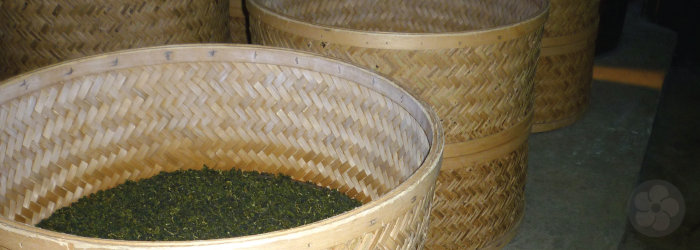 These bamboo baskets full of tea are placed over charcoal pits for gentle roasting