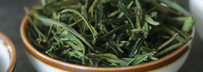 Gyokuro leaves are small, dark green, and needle-like in shape.