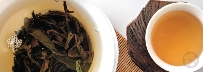 A white gaiwan clearly shows the brewing tea leaves, making it easy to tell when tea is ready.