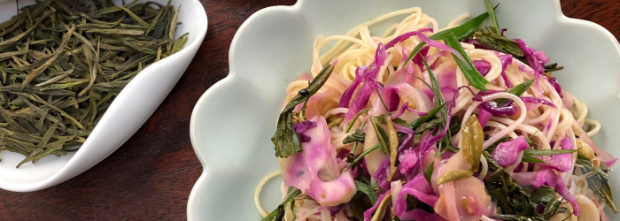capellini salad with fennel, pickled cabbage, and spring green tea leaves.