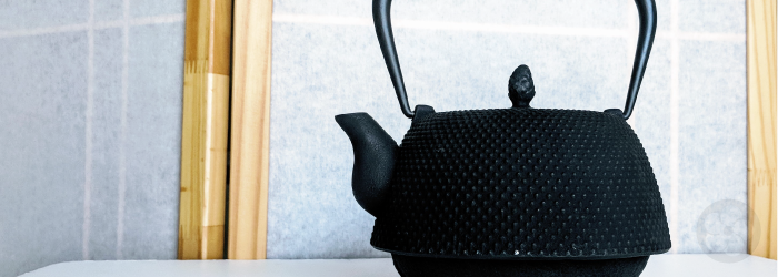 cast iron teapot or tetsubin; originally used for boiling water rather than brewing tea