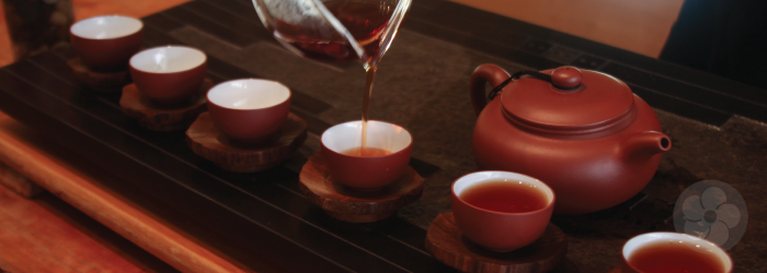 teacups with trivets in gong fu cha service with yixing teapot