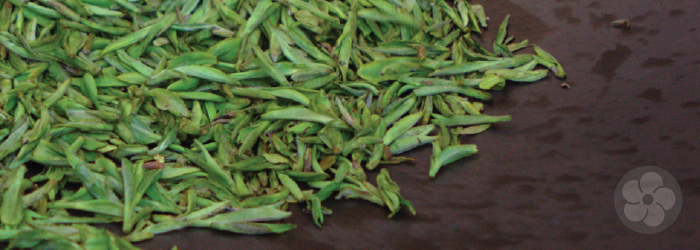 dragonwell leaves are roasted by hand in a large wok