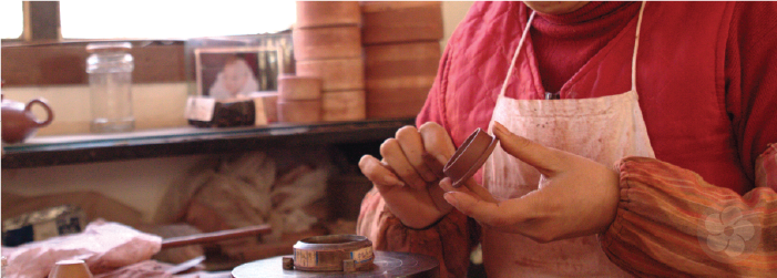 yixing teapots are carefully formed by hand without use of a potter's wheel