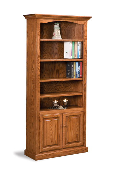 Oak bookcase shown with five adjustable shelves and two doors on bottom