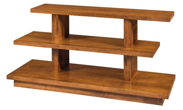 The Kewask tv stand is shown in Brown Maple with a Baywood finish