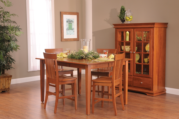 Lexington dining collection shown in Brown Maple/Malaguania
