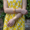 Simple gold swirl bangle