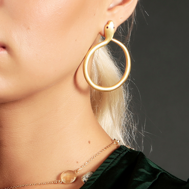 Gold serpent hoops with crystal eyes