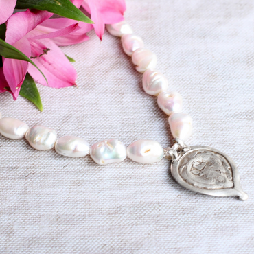 Antique weathered trinket and baroque pearl necklace