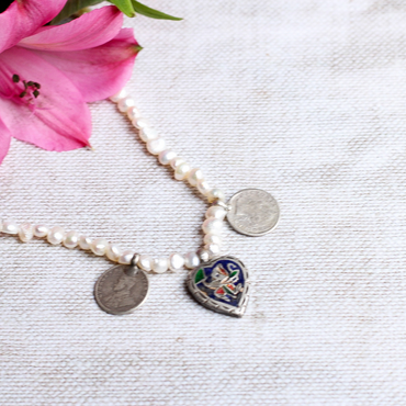 Mismatched silver enamel trinket and pearl necklace