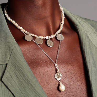 Mismatched silver coins and pearl necklace