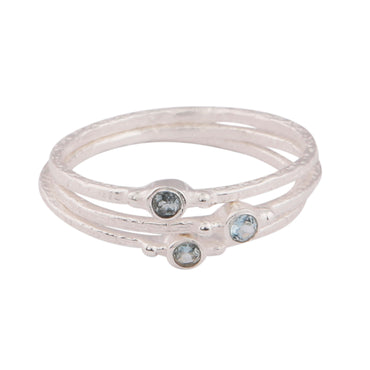 Silver circular blue topaz stacking ring trio