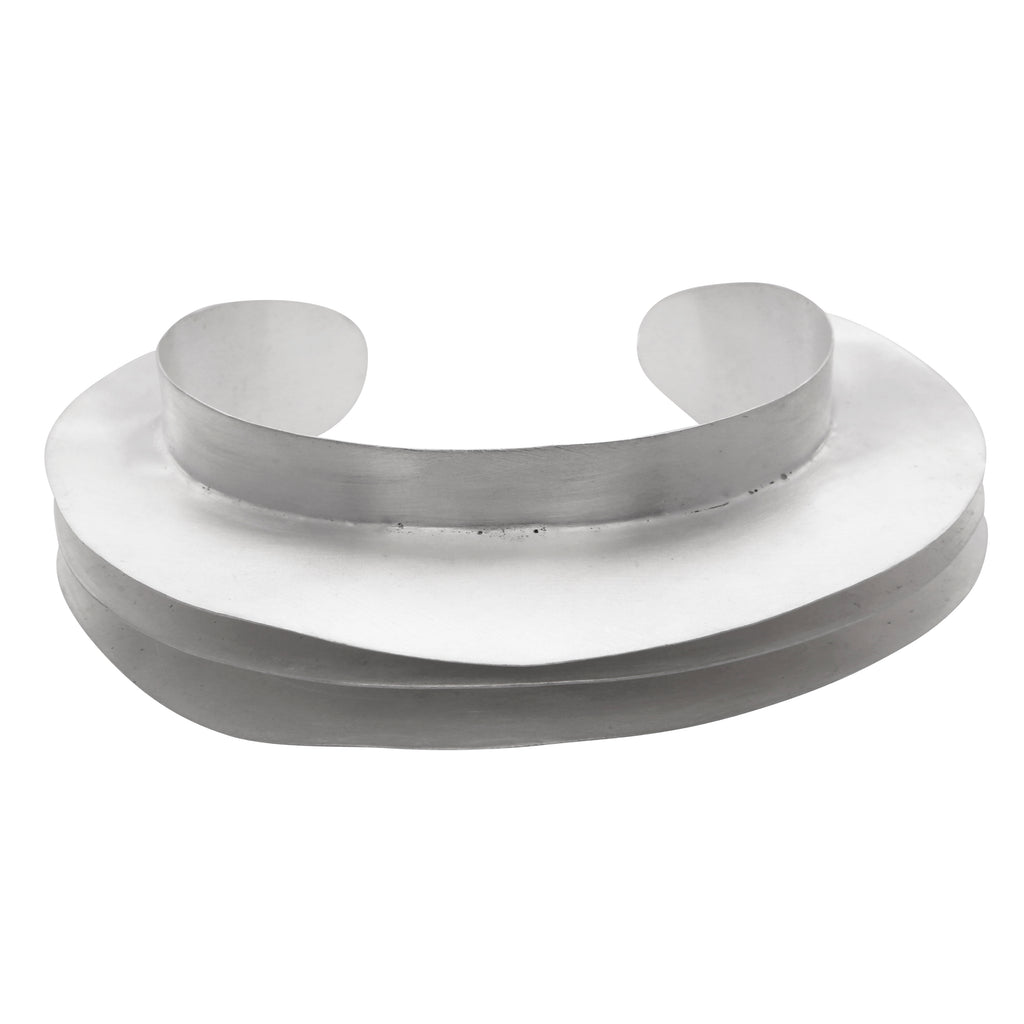 Silver curve statement bangle