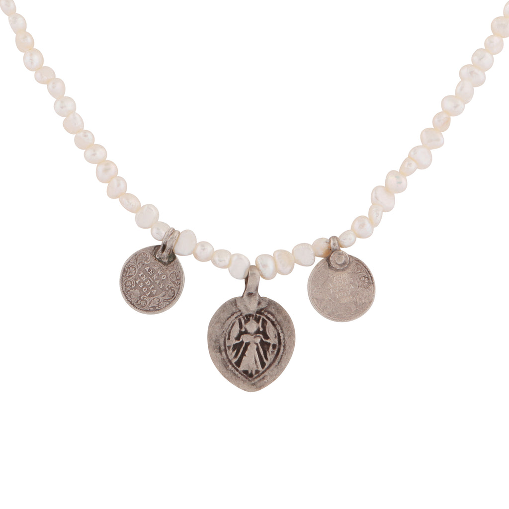 Mismatched silver charms and pearl necklace