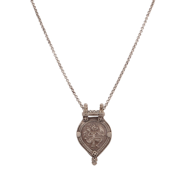 Antique family crest heart pendant