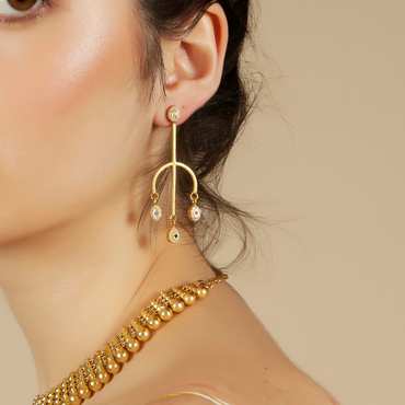 Gold spear earrings with mismatched gemstones