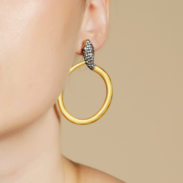 Lavish gold serpent hoops with studded crystals