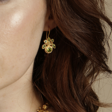 Intricate peridot heritage gold earrings