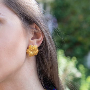 Regal flower gold studs