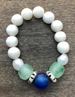 blue african trade bead, white wood, and freshwater baroque pearl bracelet