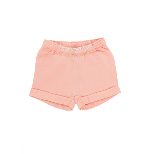 organic cotton muslin shorts for baby girl and toddler girl from tiny twig organics in apricot blush