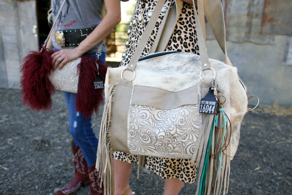 mini white cowhide duffle bag