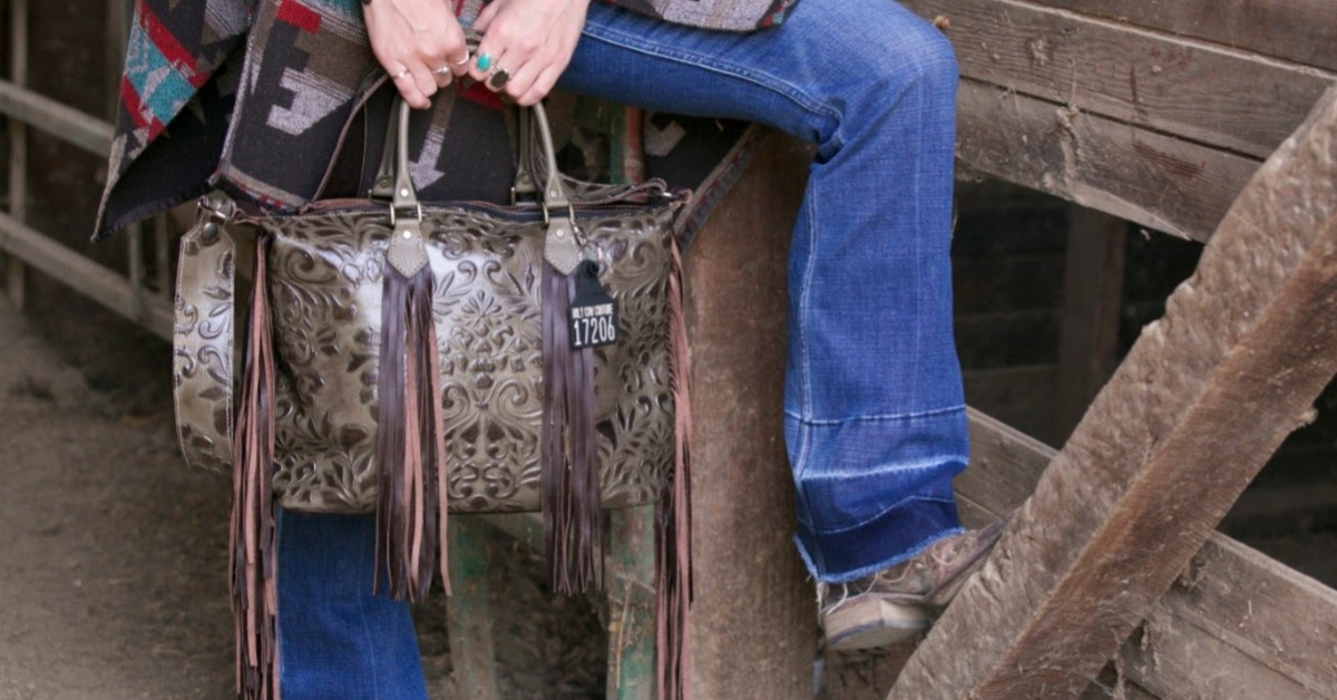 boot cut jeans with cowhide bag