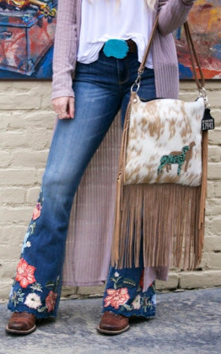 embroidered jeans with cowhide bag