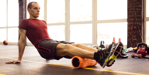 Man Stretching With Foam Roller