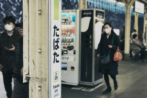 people wearing face masks in the street