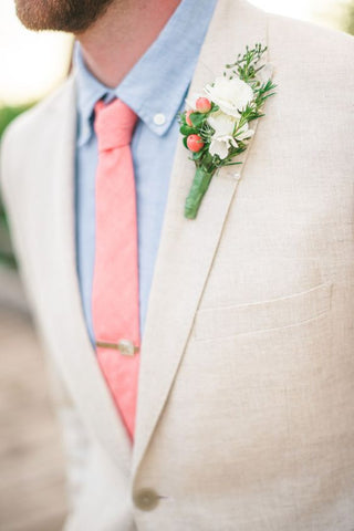 light beige suit with a pink tie