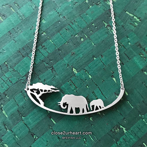 Wearable Art Collection, featuring the Stainless Steel Giraffes Necklace