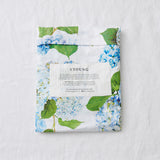 fitted cot sheet | organic cotton | hiding amongst the hydrangeas