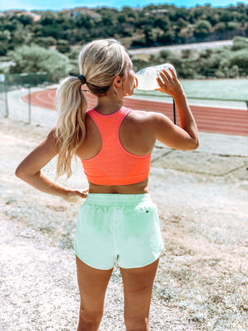 Athlete exercising with hair up in ponytail with PONY-O