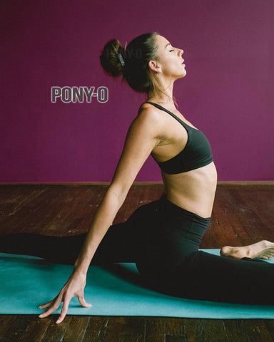 Woman doing yoga with hair up in PONY-O