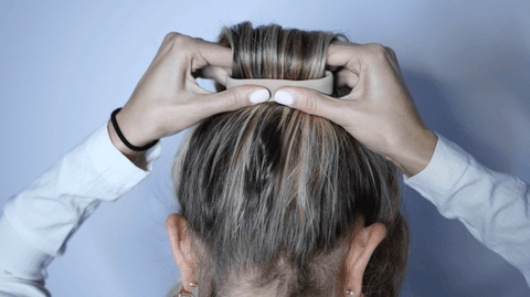 making a ponytail with thick hair