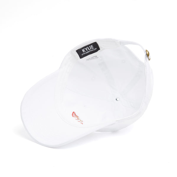 White dad hat with Kylie lips logo on front inside view
