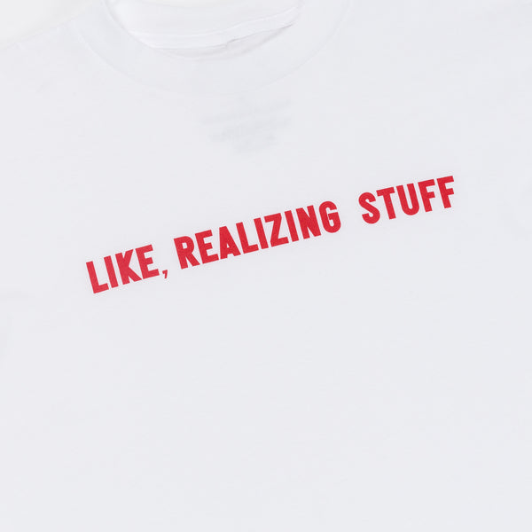 Like Realizing Stuff Tee white with pink writing front view close up